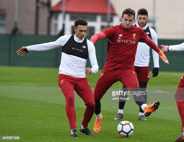 Trent AlexanderArnold and Danny Ward of Liverpool during a training session at Melwood Training Ground on April 12 2018 in Liverpool England
