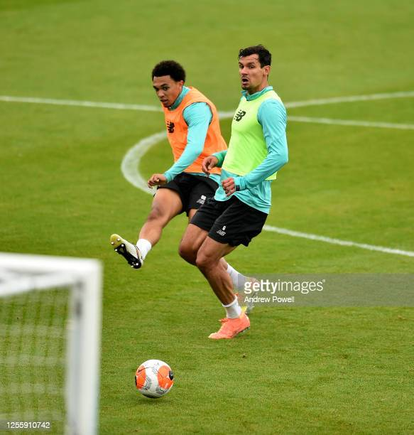 Trent AlexanderArnold and Dejan Lovren of Liverpool during a training session at Melwood Training Ground on July 13 2020 in Liverpool England