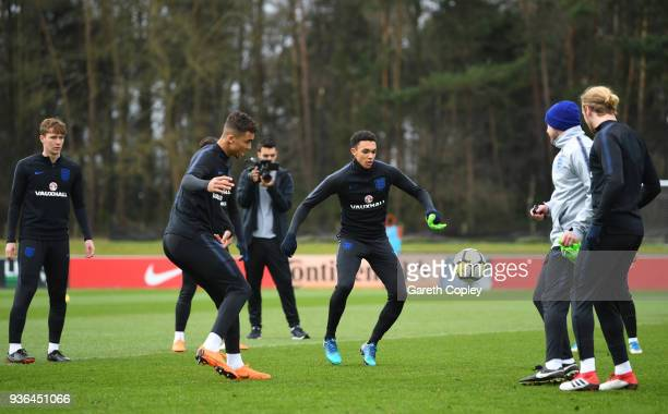 Trent AlexanderArnold and Dominic CalvertLewin peform a drill with team mates during an England U21 training session at St Georges Park on March 22...