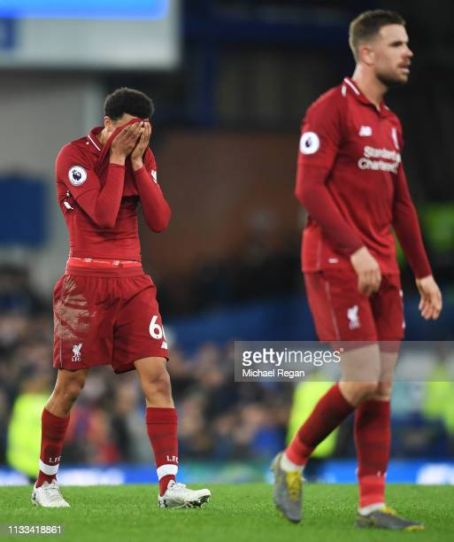 Trent AlexanderArnold and Jordan Henderson of Liverpool looks despondent after the Premier League match between Everton FC and Liverpool FC at...