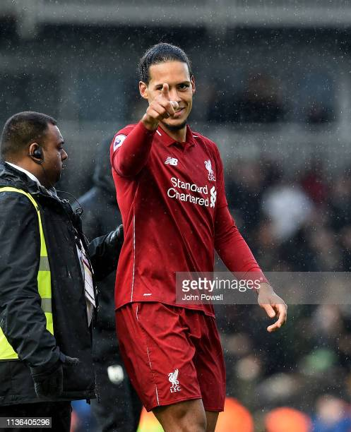 Trent AlexanderArnold and Jurgen Klopp manager of Liverpool embrace at the end of the Premier League match between Fulham FC and Liverpool FC at...