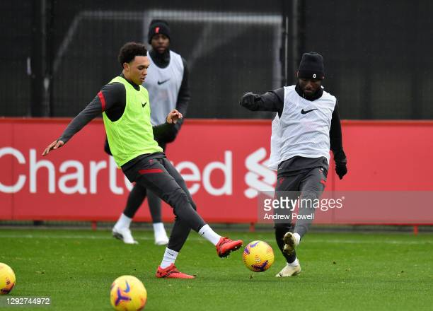 Trent Alexander-Arnold and Naby Keita of Liverpool during a training session at AXA Training Centre on December 23, 2020 in Kirkby, England.