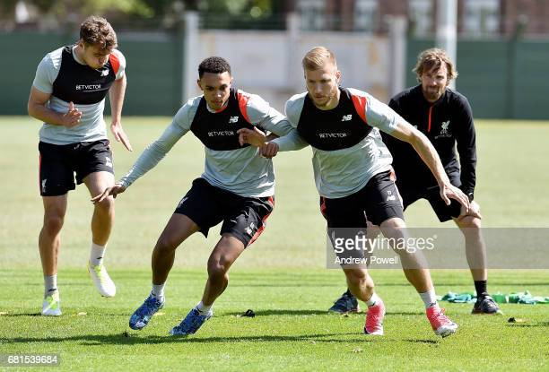 Trent AlexanderArnold and Ragnar Klavan of Liverpool during a training session at Melwood Training Ground on May 10 2017 in Liverpool England