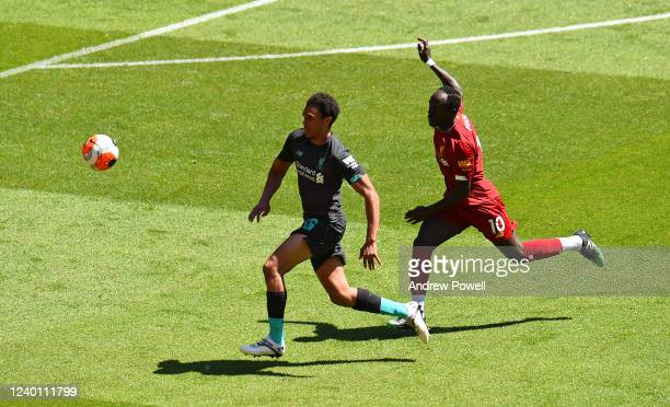 Trent AlexanderArnold and Sadio Mane of Liverpool during a training session at Anfield on June 01 2020 in Liverpool England