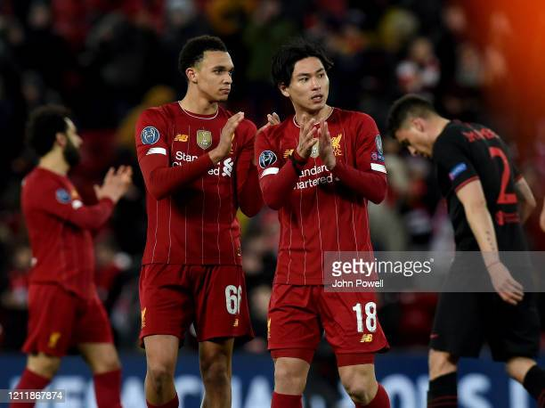 Trent AlexanderArnold and Takumi Minamino of Liverpool showing their appreciation to the fans at the end of the UEFA Champions League round of 16...