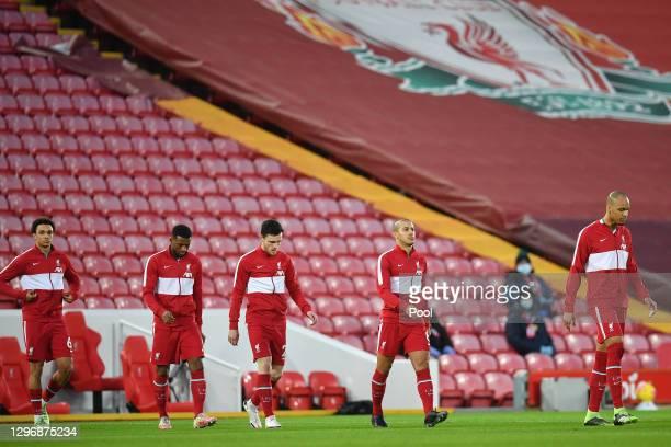 Trent Alexander-Arnold, Fabinho, Georginio Wijnaldum, Andy Robertson, Thiago Alcantara and Fabinho of Liverpool enter the pitch ahead of the Premier...