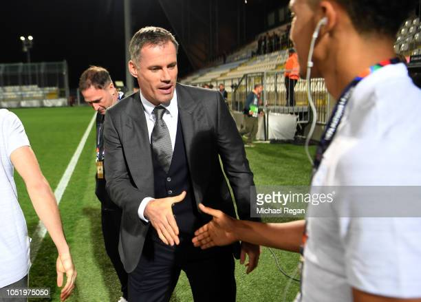 Trent AlexanderArnold of Englan shakes hands with pundit Jamie Carragher prior to the UEFA Nations League A Group Four match between Croatia and...