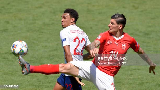 Trent AlexanderArnold of England and Steven Zuber of Switzerland compete for the ball during the UEFA Nations League Third Place Playoff match...