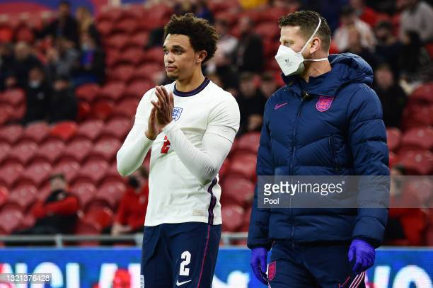 Trent Alexander-Arnold of England applauds the fans as he leaves the pitch after picking up an injury during the international friendly match between...