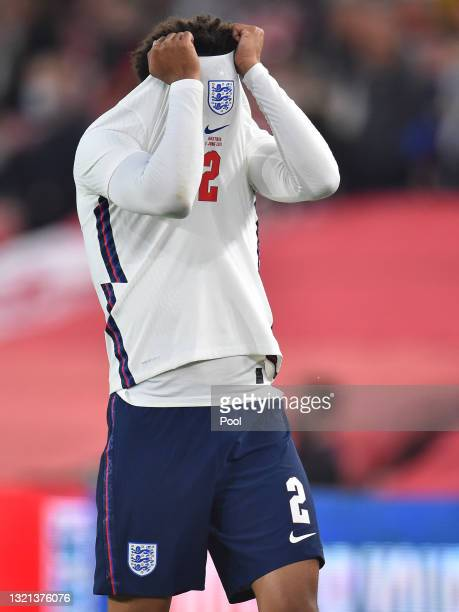 Trent Alexander-Arnold of England looks dejected after picking up an injury during the international friendly match between England and Austria at...