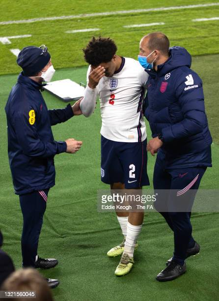 Trent Alexander-Arnold of England reacts after being substituted with a injury during the international friendly match between England and Austria at...