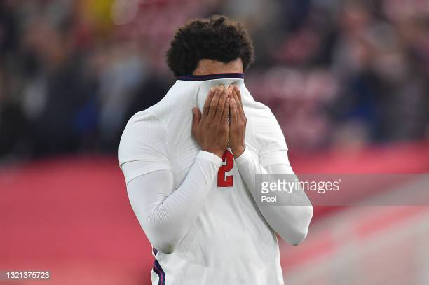 Trent Alexander-Arnold of England reacts after picking up an injury during the international friendly match between England and Austria at Riverside...