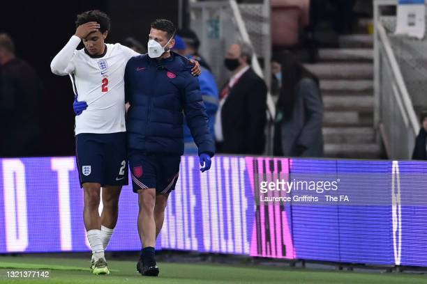 Trent Alexander-Arnold of England reacts as he is substituted after picking up an injury during the international friendly match between England and...