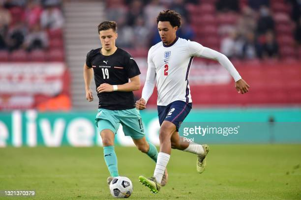 Trent Alexander-Arnold of England runs with the ball whilst under pressure from Christoph Baumgartner of Austria during the international friendly...