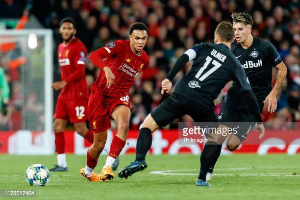 Trent AlexanderArnold of FC Liverpool and Andreas Ulmer of RB Salzburg battle for the ball during the UEFA Champions League group E match between...