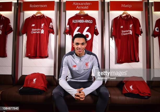 Trent AlexanderArnold of Liverpool after signing a contract extension at Anfield on January 18 2019 in Liverpool England