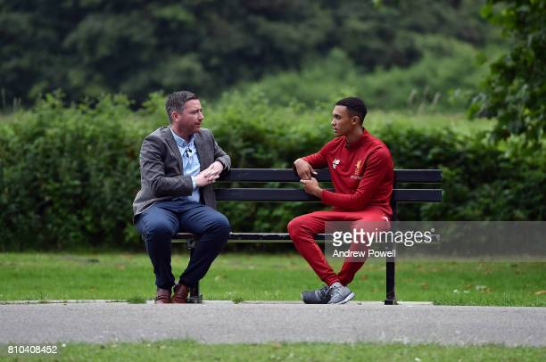 Trent AlexanderArnold of Liverpool after signing his contract extension at Melwood Training Ground on July 7 2017 in Liverpool England