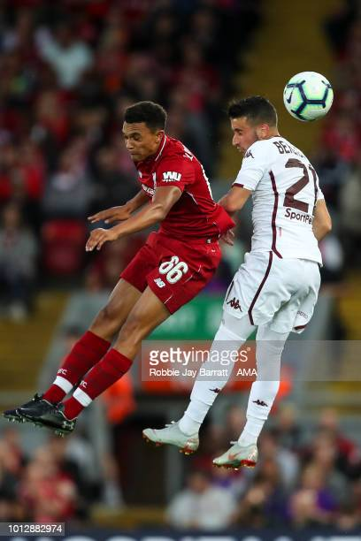Trent AlexanderArnold of Liverpool and Alejandro Berenguer of Torino during the preseason friendly between Liverpool and Torino at Anfield on August...
