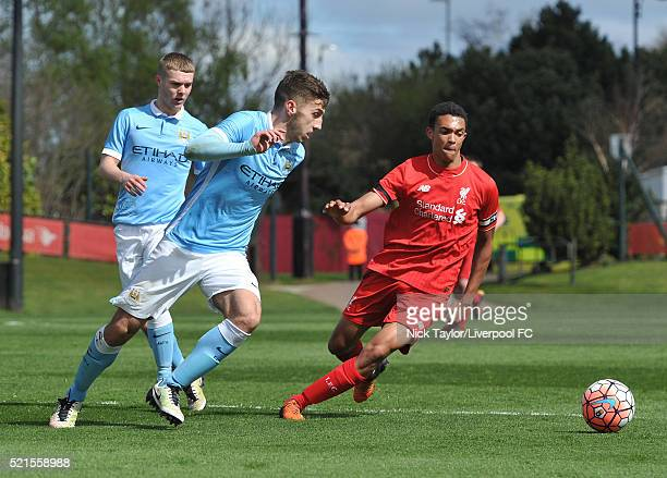 Trent AlexanderArnold of Liverpool and Charlie Oliver of Manchester City in action during the Liverpool v Manchester City U18 Premier League game at...