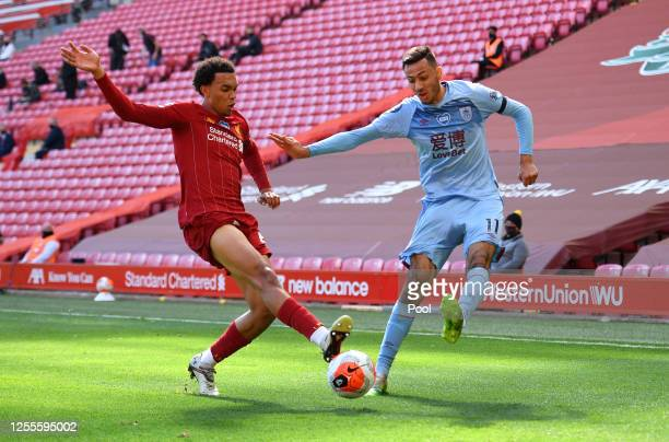 Trent AlexanderArnold of Liverpool and Dwight McNeil of Burnley battle for the ball during the Premier League match between Liverpool FC and Burnley...