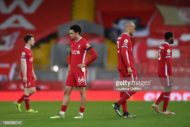 Trent Alexander-Arnold of Liverpool and Fabinho of Liverpool look dejected following their team's defeat in the Premier League match between...