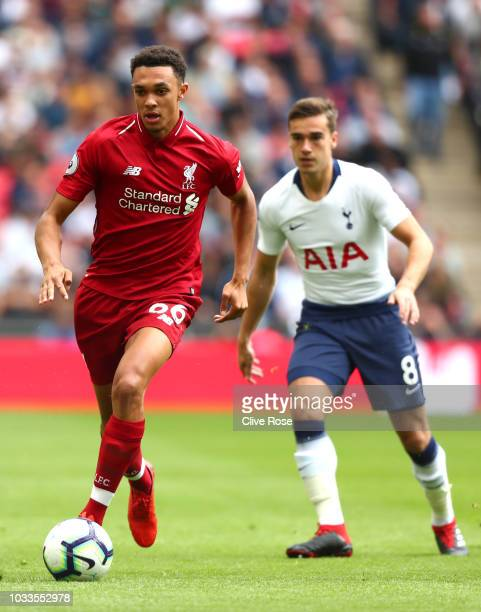 Trent AlexanderArnold of Liverpool and Harry Winks of Tottenham Hotspur battle for the ball during the Premier League match between Tottenham Hotspur...