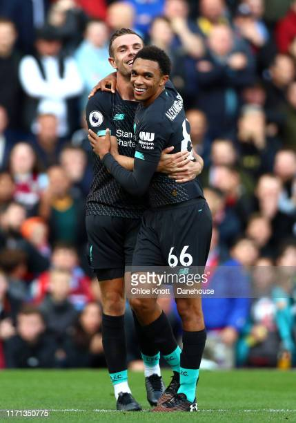 Trent AlexanderArnold of Liverpool and Jordan Henderson of Liverpool celebrates their teams first goal during the Premier League match between...