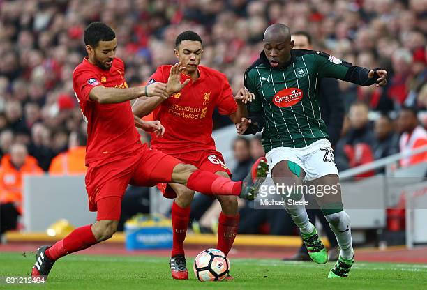 Trent AlexanderArnold of Liverpool and Kevin Stewart of Liverpool attempt to tackle Arnold Garita of Plymouth Argyle during The Emirates FA Cup Third...