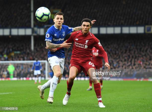 Trent AlexanderArnold of Liverpool and Lucas Digne of Everton watch the ball during the Premier League match between Everton FC and Liverpool FC at...