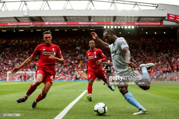 Trent AlexanderArnold of Liverpool and Michail Antonio of West Ham United during the Premier League match between Liverpool FC and West Ham United at...