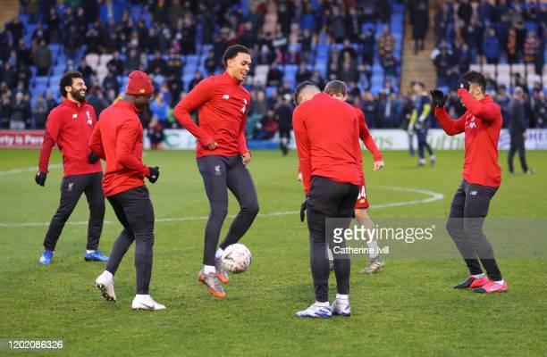 Trent AlexanderArnold of Liverpool and teammates warm up prior to the FA Cup Fourth Round match between Shrewsbury Town and Liverpool at New Meadow...