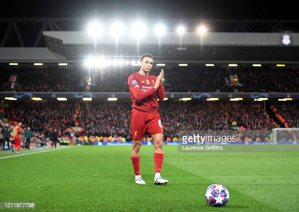 Trent AlexanderArnold of Liverpool applauds the supporters in the Kop as he walks to take a corner during the UEFA Champions League round of 16...
