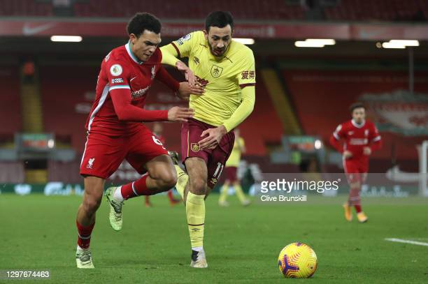 Trent Alexander-Arnold of Liverpool battles for possession with Dwight McNeil of Burnley during the Premier League match between Liverpool and...