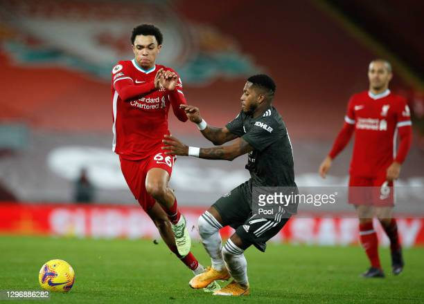Trent Alexander-Arnold of Liverpool battles for possession with Fred of Manchester United during the Premier League match between Liverpool and...