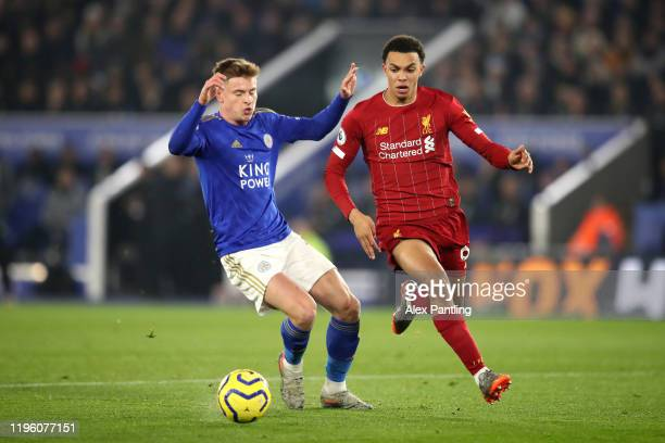 Trent AlexanderArnold of Liverpool battles for possession with Harvey Barnes of Leicester City during the Premier League match between Leicester City...