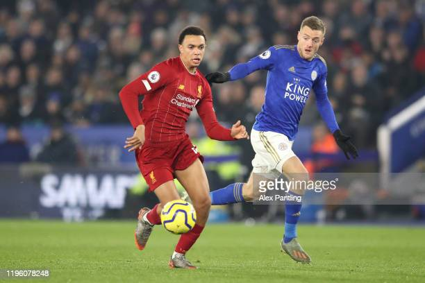 Trent AlexanderArnold of Liverpool battles for possession with Jamie Vardy of Leicester City during the Premier League match between Leicester City...