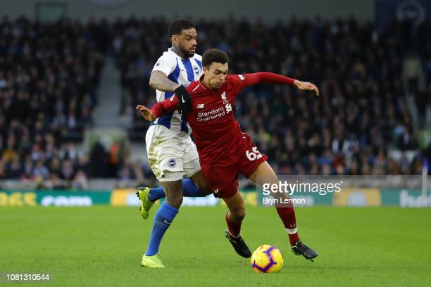 Trent AlexanderArnold of Liverpool battles for possession with Jurgen Locadia of Brighton and Hove Albion during the Premier League match between...