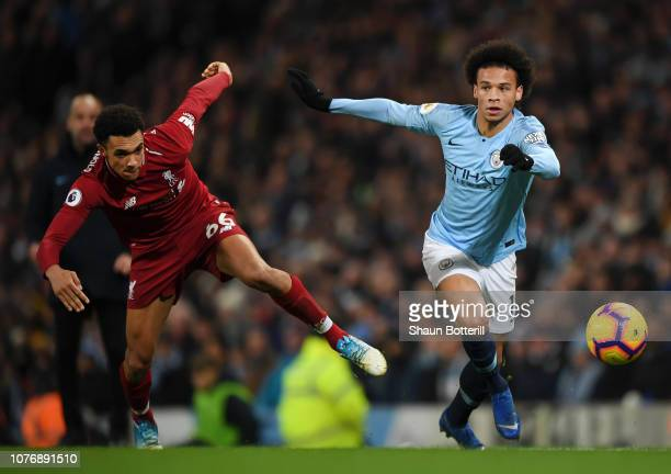 Trent AlexanderArnold of Liverpool battles for possession with Leroy Sane of Manchester City during the Premier League match between Manchester City...