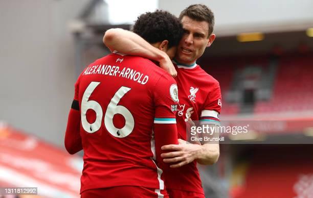 Trent Alexander-Arnold of Liverpool celebrates after scoring their team's second goal with teammate James Milner during the Premier League match...