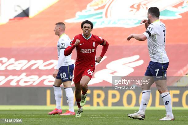Trent Alexander-Arnold of Liverpool celebrates after scoring their team's second goal during the Premier League match between Liverpool and Aston...