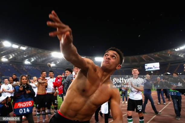 Trent AlexanderArnold of Liverpool celebrates after the full time whistle as Liverpool qualify for the Champions League Final during the UEFA...