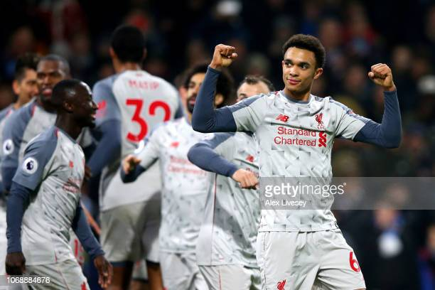 Trent AlexanderArnold of Liverpool celebrates after Xherdan Shaqiri of Liverpool scored their third goal during the Premier League match between...