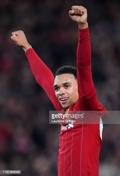 Trent Alexander-Arnold of Liverpool celebrates his sides fourth goal during the Premier League match between Liverpool FC and Everton FC at Anfield...
