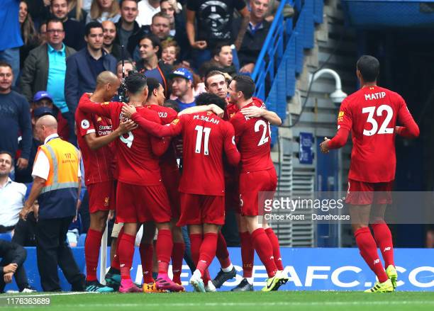 Trent AlexanderArnold of Liverpool celebrates scoring his teams first goal during the Premier League match between Chelsea FC and Liverpool FC at...