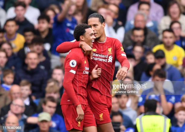 Trent AlexanderArnold of Liverpool celebrates scoring the opening goal with Virgil van Dijk of Liverpool during the Premier League match between...