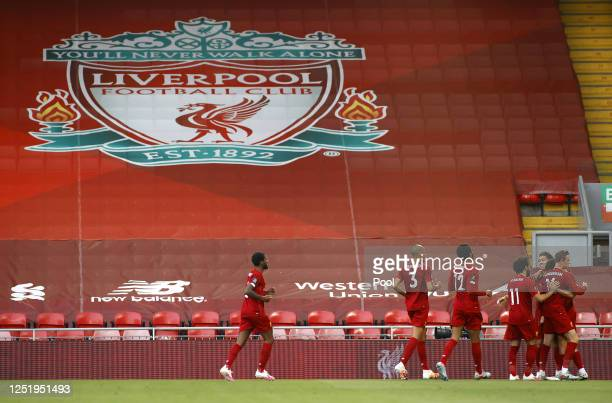 Trent Alexander-Arnold of Liverpool celebrates with his team after scoring his teams first goal during the Premier League match between Liverpool FC...