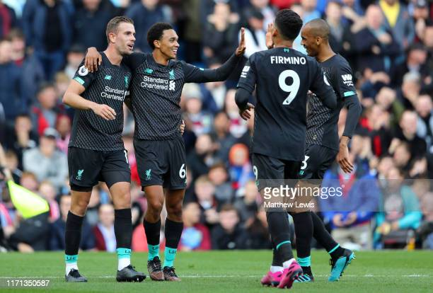 Trent Alexander-Arnold of Liverpool celebrates with Jordan Henderson of Liverpool after scoring his sides first goal during the Premier League match...
