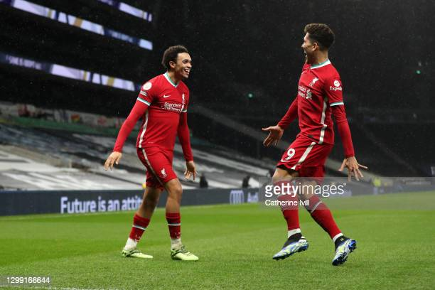 Trent Alexander-Arnold of Liverpool celebrates with Roberto Firmino of Liverpool after scoring their team's second goal during the Premier League...