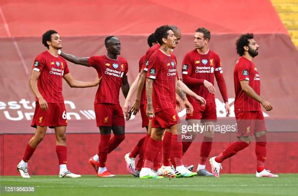 Trent AlexanderArnold of Liverpool celebrates with Sadio Mane of Liverpool and th erest of his team after scoring his sides first goal during the...