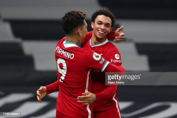 Trent Alexander-Arnold of Liverpool celebrates with teammate Roberto Firminho after scoring his team's second goal during the Premier League match...